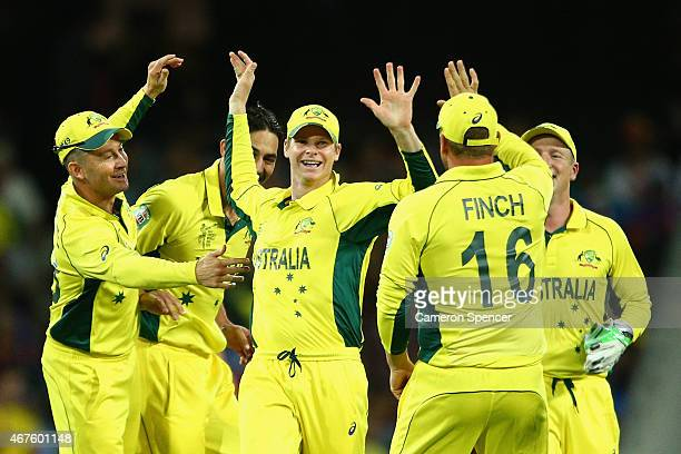 Steve Smith of Australia celebrates with team mates after running out Ravindra Jadeja of India during the 2015 Cricket World Cup Semi Final match...