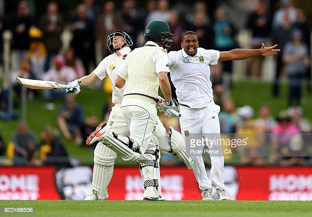 Steve Smith of Australia collides with Vernon Philander of South Africa during day one of the Second Test match between Australia and South Africa at...