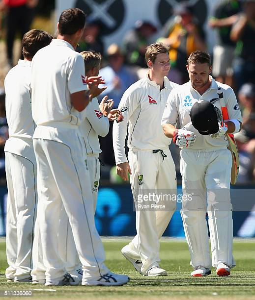 Steve Smith of Australia congratulates Brendon McCullum of New Zealand as he walks out to bat in his final test match during day one of the Test...