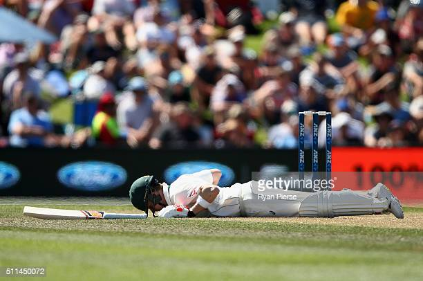Steve Smith of Australia falls to the ground after he was hit in the head by a delivery from Neil Wagner of New Zealand during day two of the Test...