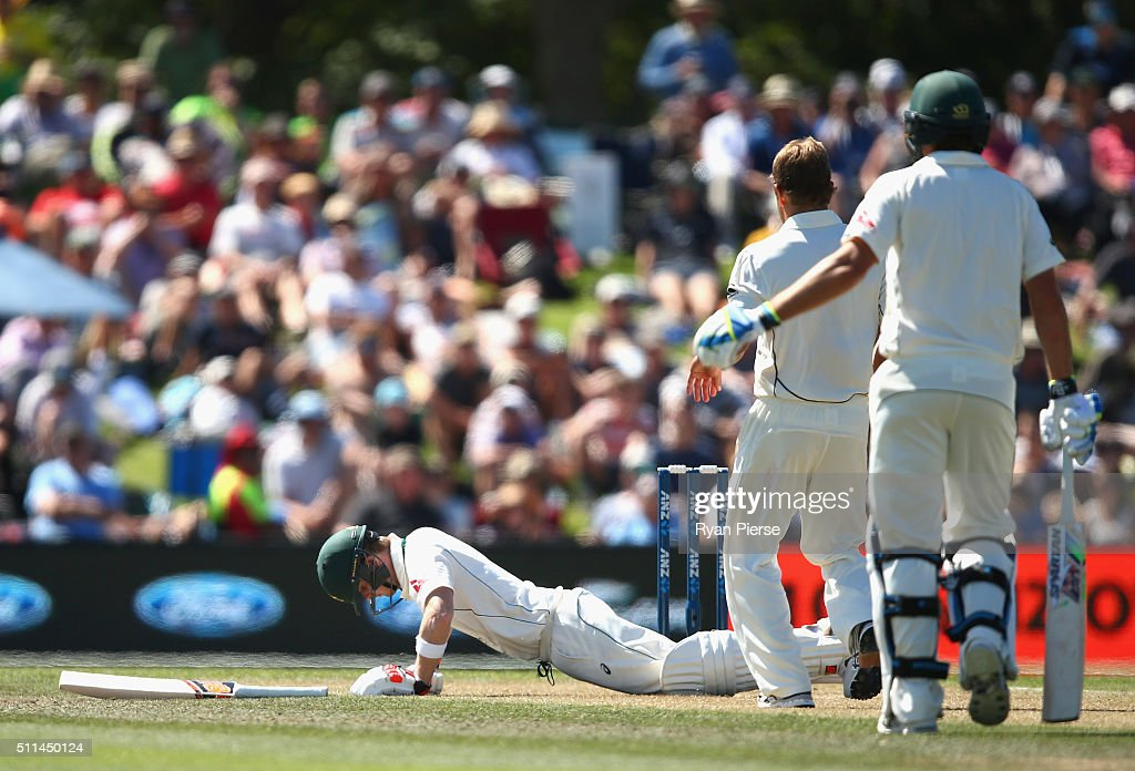 Steve Smith of Australia falls to the ground after he was hit on the helmet by a delivery from <a gi-track='captionPersonalityLinkClicked' href=/galleries/search?phrase=Neil+Wagner+-+Cricket+Player&family=editorial&specificpeople=12902899 ng-click='$event.stopPropagation()'>Neil Wagner</a> of New Zealand during day two of the Test match between New Zealand and Australia at Hagley Oval on February 21, 2016 in Christchurch, New Zealand.