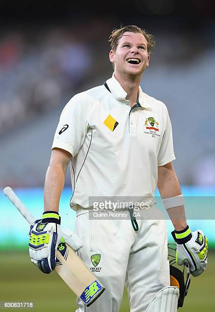 Steve Smith of Australia has a laugh as he walks from the field during a rain delay after making his century during day four of the Second Test match...