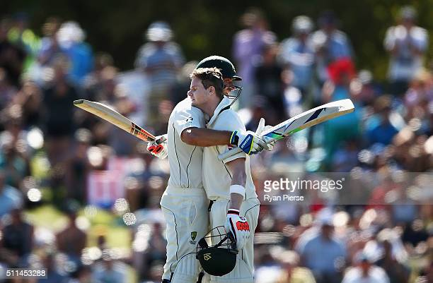 Steve Smith of Australia is congratulated by Joe Burns of Australia after reaching his century during day two of the Test match between New Zealand...