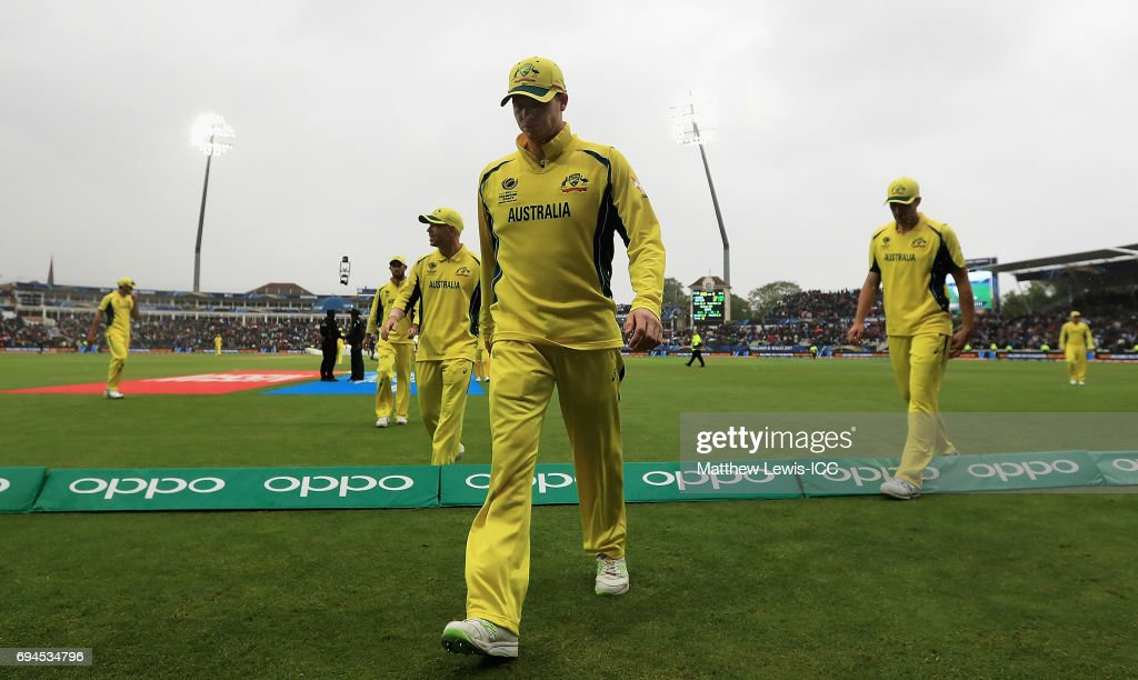 Steve Smith of Australia leads his team off the field, as rain delays play during the ICC Champions Trophy match between England and Australia at Edgbaston on June 10, 2017 in Birmingham, England.