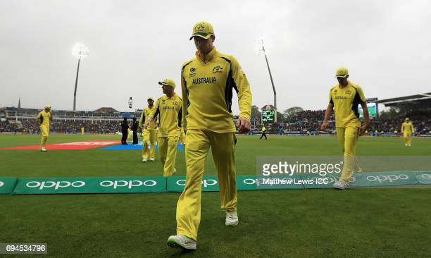 Steve Smith of Australia leads his team off the field as rain delays play during the ICC Champions Trophy match between England and Australia at...