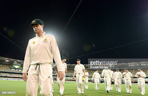 Steve Smith of Australia looks dejected as he leads his team from the field during day four of the First Test match between Australia and Pakistan at...