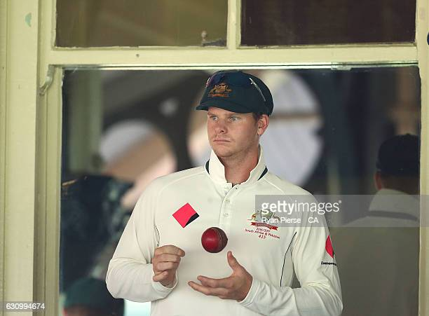 Steve Smith of Australia looks on during a rain delay during day three of the Third Test match between Australia and Pakistan at Sydney Cricket...