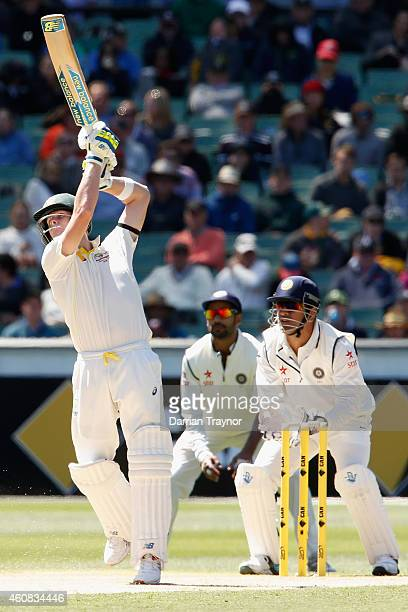 Steve Smith of Australia plays a straight drive during day one of the Third Test match between Australia and India at Melbourne Cricket Ground on...