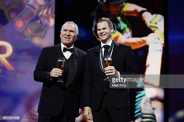 Steve Smith of Australia poses on stage with Allan Border after winning the Allan Border Medal during the 2015 Allan Border Medal at Carriageworks on...
