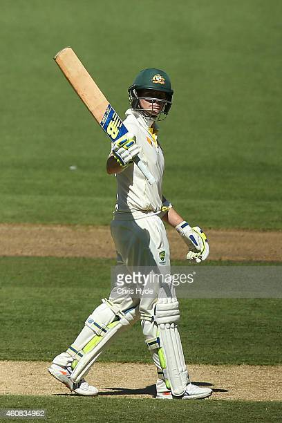 Steve Smith of Australia raises his bat after reaching 50 runs during day one of the Third Test match between Australia and India at Melbourne...