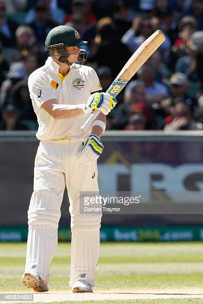 Steve Smith of Australia raises his bat after scoring 50 runs during day one of the Third Test match between Australia and India at Melbourne Cricket...