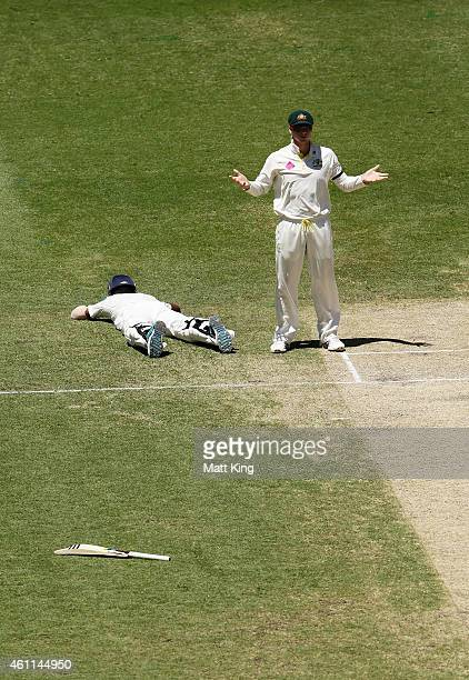 Steve Smith of Australia reacts after a missed run out chance on Lokesh Rahul of India during day three of the Fourth Test match between Australia...