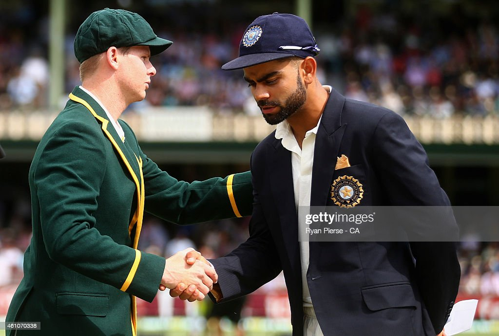 Steve Smith of Australia shakes hands with Virat Kohli of India at the coin toss during day one of the Fourth Test match between Australia and India...