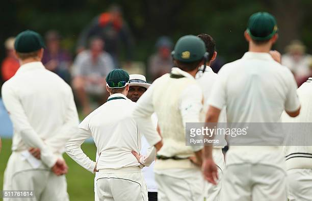 Steve Smith of Australia speaks with Umpire Ranmore Martinesz after Kane Williamson of New Zealand was given not out after an LBW refferal during day...