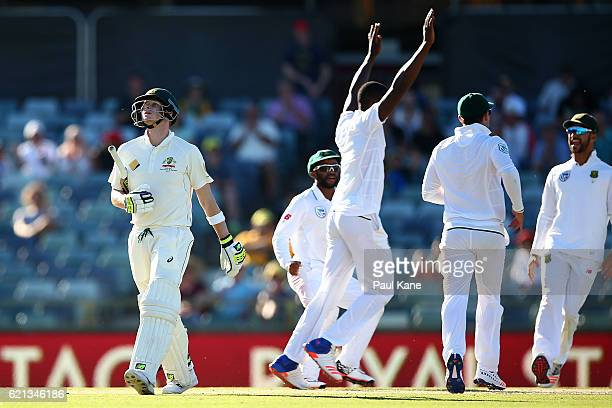 Steve Smith of Australia walks back to the rooms after beimng dismissed by Kagiso Rabada of South Africa during day four of the First Test match...