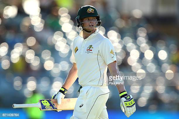 Steve Smith of Australia walks back to the rooms after being dismissed by Kagiso Rabada of South Africa during day four of the First Test match...