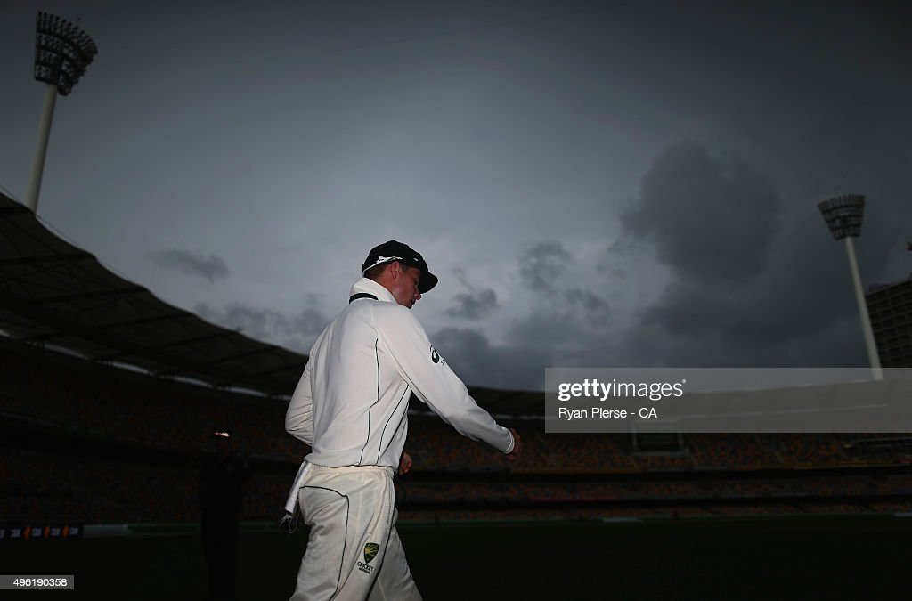 Steve Smith of Australia walks from the ground as rain stops play during day four of the First Test match between Australia and New Zealand at The...