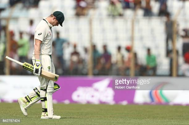 Steve Smith of Australia walks off after he was bowled by Taijul Islam of Bangladesh aduring day two of the Second Test match between Bangladesh and...