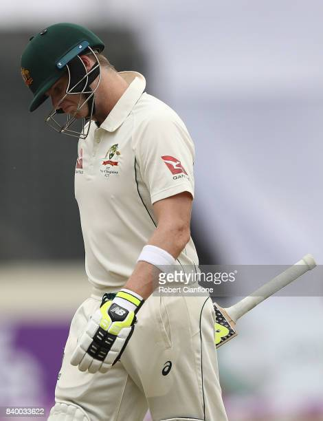 Steve Smith of Australia walks off after he was dismissed by Mehedi Hasan Miraj of Bangladesh during day two of the First Test match between...