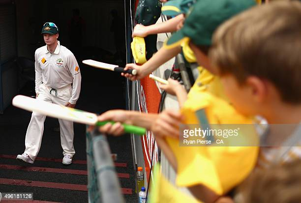 Steve Smith of Australia walks out to field during day four of the First Test match between Australia and New Zealand at The Gabba on November 8 2015...