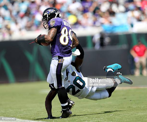 Steve Smith of the Baltimore Ravens catches a pass in front of Jalen Ramsey of the Jacksonville Jaguars at EverBank Field on September 25 2016 in...