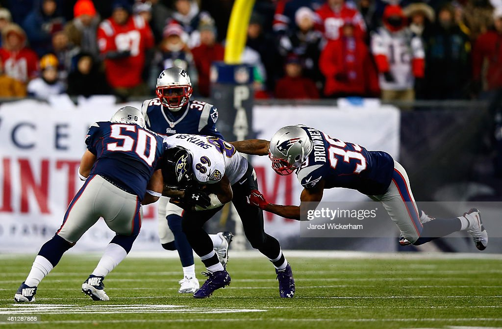 Steve Smith of the Baltimore Ravens makes a catch against Rob Ninkovich and Brandon Browner of the New England Patriots in the first quarter during...