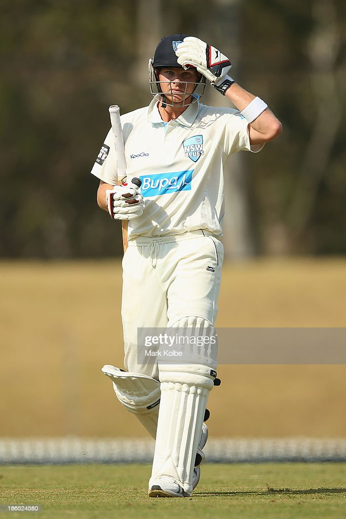 Steve Smith of the Blues looks dejected as leaves the field after being dismissed during day three of the Sheffield Shield match between the New South Wales Blues and the Tasmania Tigers at Blacktown International Sportspark on November 1, 2013 in Sydney, Australia.