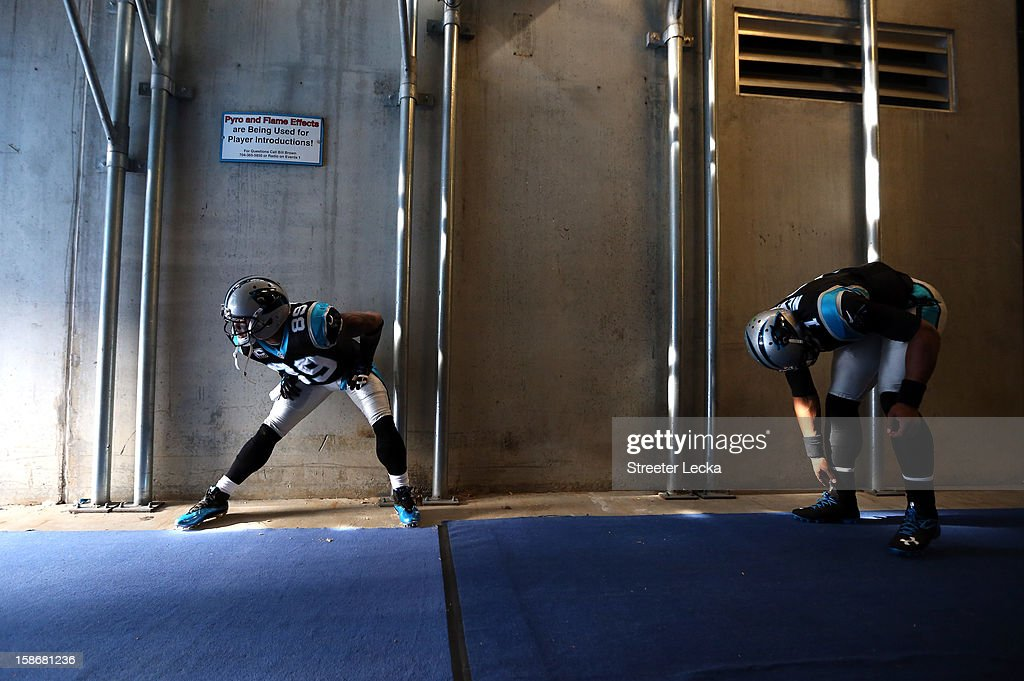 Steve Smith #89 of the Carolina Panthers and teammate <a gi-track='captionPersonalityLinkClicked' href=/galleries/search?phrase=Cam+Newton+-+American+Football+Quarterback&family=editorial&specificpeople=4516761 ng-click='$event.stopPropagation()'>Cam Newton</a> #1 stretch in the tunnel before going onto the field ahead of their game against the Oakland Raiders at Bank of America Stadium on December 23, 2012 in Charlotte, North Carolina.
