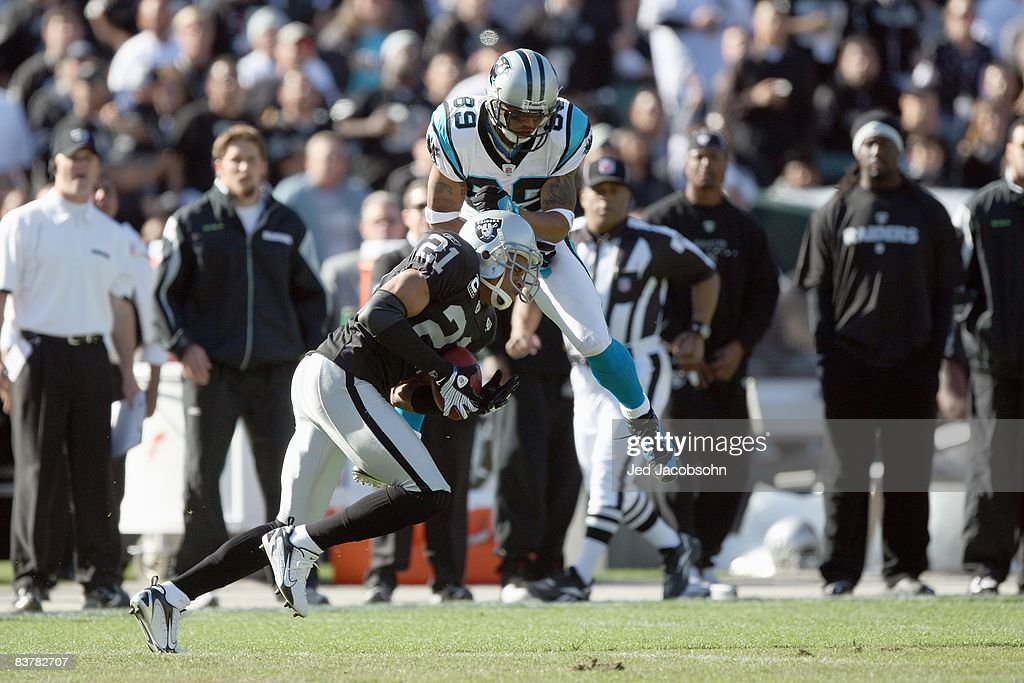 Steve Smith #89 of the Carolina Panthers collides with Nnamdi Asomugha #21of the Oakland Raiders at the Oakland-Alameda County Coliseum on November 9, 2008 in Oakland, California.