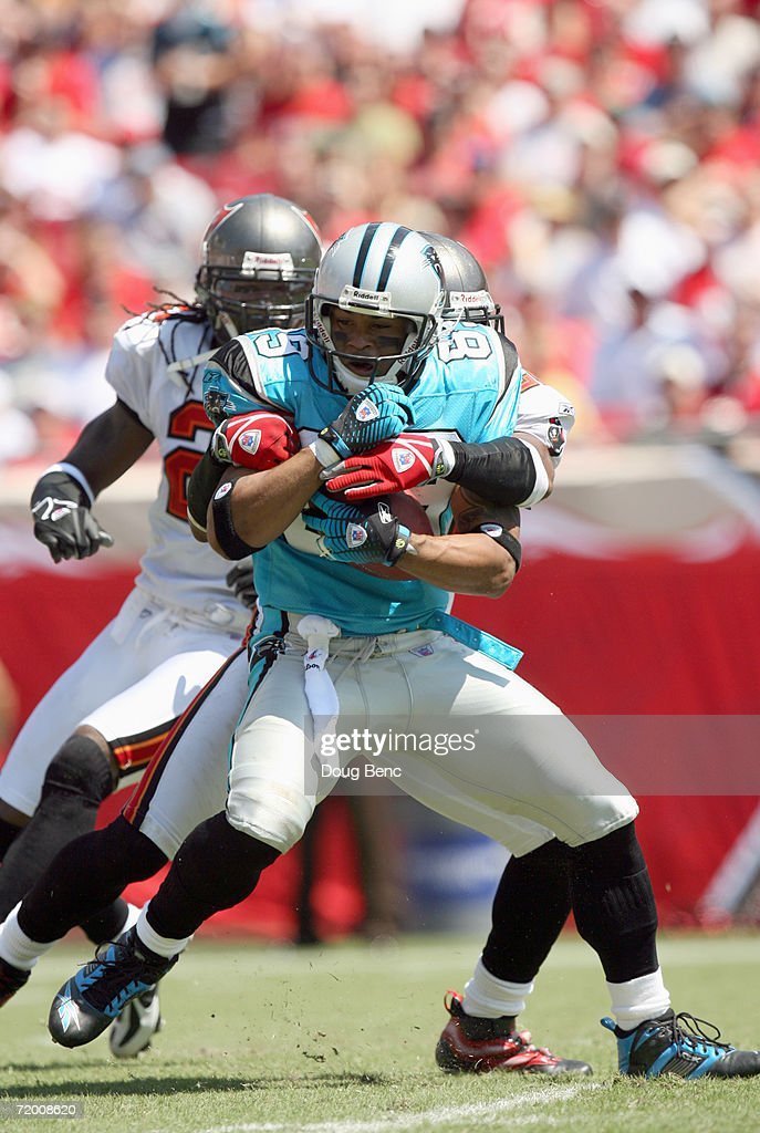 Steve Smith #89 of the Carolina Panthers grips the ball as he is tackled during the game against the Tampa Bay Buccaneers at Raymond James Stadium on September 24, 2006 in Tampa, Florida.
