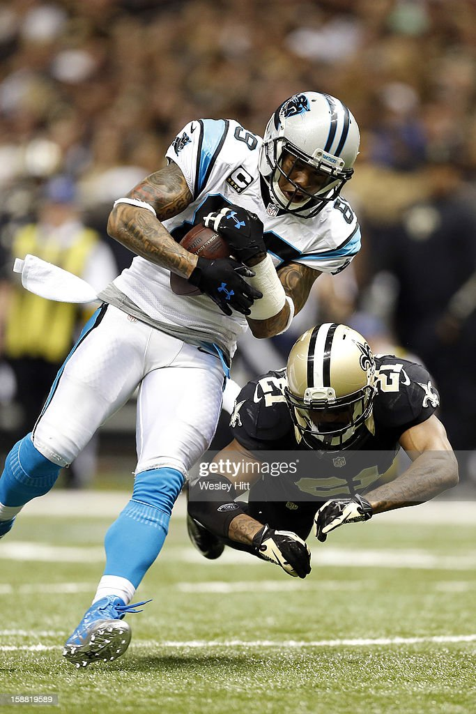 Steve Smith #89 of the Carolina Panthers is tackled after catching a pass by Patrick Robinson #21of the New Orleans Saints at Mercedes-Benz Superdome on December 30, 2012 in New Orleans, Louisiana. The Panthers defeated the Saints 44-38.