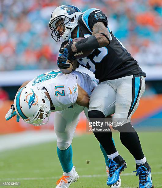 Steve Smith of the Carolina Panthers runs past the attempted tackle by Brent Grimes of the Miami Dolphins on November 24 2013 at Sun Life Stadium in...