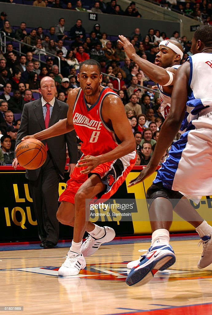 Steve Smith of the Charlotte Bobcats drives to the hoop against Corey Maggette and Elton Brand of the Los Angeles Clippers on December 6 2004 at the...