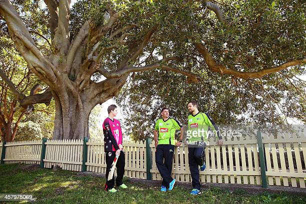 Steve Smith of the Sixers and Mike Hussey and Dirk Nannes of the Thunder talk together during a joint Sydney Thunder and Sydney Sixers Big Bash...