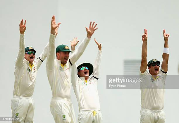 Steve Smith Shaun Marsh Michael Clarke and Shane Watson of Australia appeal for a wicket during day three of the First Test match between Australia...