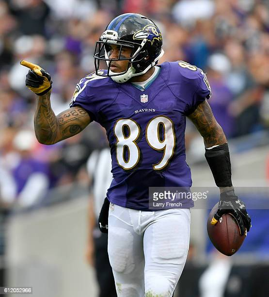 Steve Smith Sr #89 of the Baltimore Ravens celebrates after scoring a touchdown in the fourth quarter against the Oakland Raiders at MT Bank Stadium...