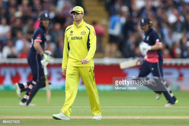 Steve Smith the captain of Australia looks on as Eoin Morgan and Ben Stokes continue their fourth wicket partnership during the ICC Champions Trophy...