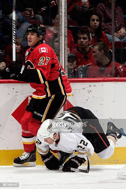 Steve Staios of the Calgary Flames skates against Todd Marchant of the Anaheim Ducks on March 23 2010 at Pengrowth Saddledome in Calgary Alberta...