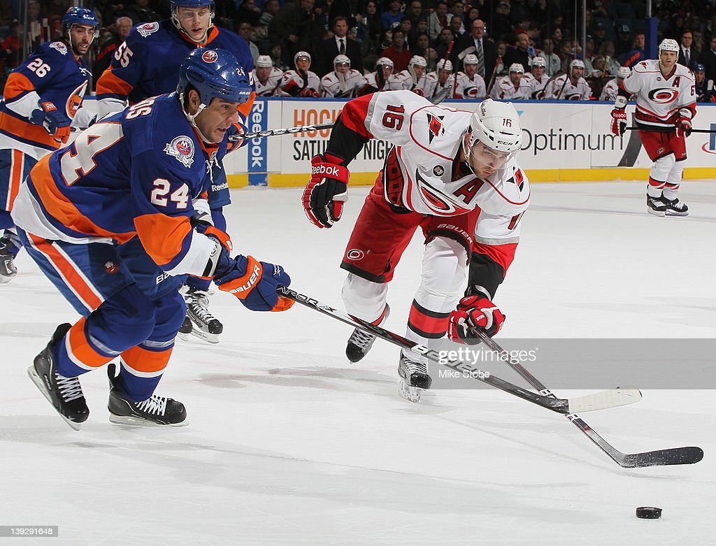 <a gi-track='captionPersonalityLinkClicked' href=/galleries/search?phrase=Steve+Staios&family=editorial&specificpeople=171909 ng-click='$event.stopPropagation()'>Steve Staios</a> #24 of the New York Islanders and Brandon Sutter #16 of the Carolina Hurricanes lunge for the puck at Nassau Veterans Memorial Coliseum on February 18, 2012 in Uniondale, New York. The Islanders defeated the Hurricanes 4-3.