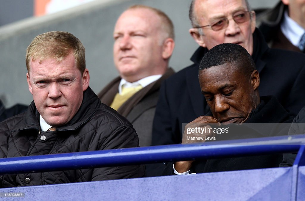 Steve Staunton (L) looks on with Wolverhampton Wanderers Manager Terry Connor prior to the Barclays Premier League match between Bolton Wanderers and Swansea City at Reebok Stadium on April 21, 2012 in Bolton, England.