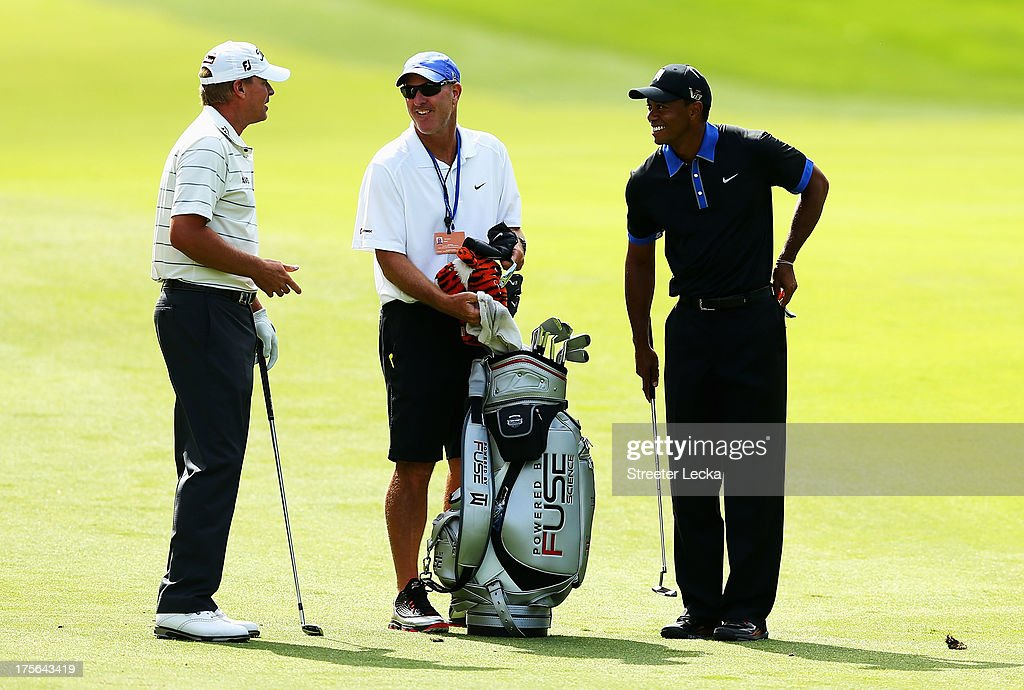 <a gi-track='captionPersonalityLinkClicked' href=/galleries/search?phrase=Steve+Stricker&family=editorial&specificpeople=239196 ng-click='$event.stopPropagation()'>Steve Stricker</a> (L) and <a gi-track='captionPersonalityLinkClicked' href=/galleries/search?phrase=Tiger+Woods&family=editorial&specificpeople=157537 ng-click='$event.stopPropagation()'>Tiger Woods</a> of the United States wait with Joe Lacava during a practice round prior to the start of the 95th PGA Championship at Oak Hill Country Club on August 5, 2013 in Rochester, New York.