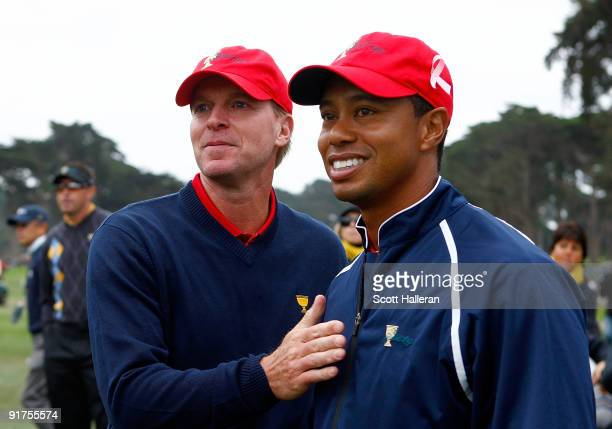 Steve Stricker and Tiger Woods of the USA Team celebrate after the USA defeated the International Team 195 to 145 to win The Presidents Cup at...