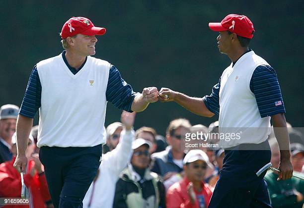 Steve Stricker and Tiger Woods of the USA Team celebrate on the first green during the Day Two Fourball Matches of The Presidents Cup at Harding Park...