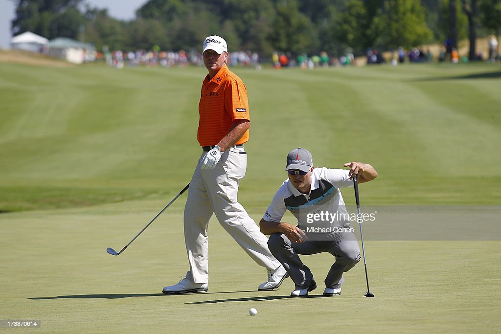 <a gi-track='captionPersonalityLinkClicked' href=/galleries/search?phrase=Steve+Stricker&family=editorial&specificpeople=239196 ng-click='$event.stopPropagation()'>Steve Stricker</a> (L) and <a gi-track='captionPersonalityLinkClicked' href=/galleries/search?phrase=Zach+Johnson+-+Golfista&family=editorial&specificpeople=217976 ng-click='$event.stopPropagation()'>Zach Johnson</a> prepare to putt on the 19th green during the second round of the John Deere Classic held at TPC Deere Run on July 12, 2013 in Silvis, Illinois.