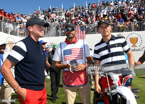 Steve Stricker Captain of the US Team Jordan Spieth of the US Team and caddie Michael Greller on the first tee during the Sunday singles matches at...