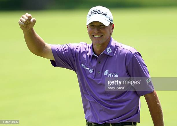 Steve Stricker celebrates after holing out for an eagle 2 on the par 4 2nd hole during the third round of the Memorial Tournament presented by...