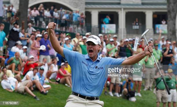 Steve Stricker celebrates making a birdie on the 18th green to win the John Deere Classic at TPC Deere Run on July 10 2011 in Silvis Illinois
