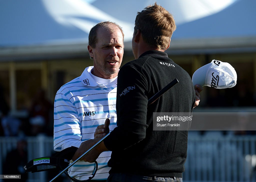 Steve Stricker congratulaes Ian Poulter of England after Poulter won their match 3 and 2 in 16 holes during the quarterfinal round of the World Golf Championships - Accenture Match Play at the Golf Club at Dove Mountain on February 23, 2013 in Marana, Arizona.