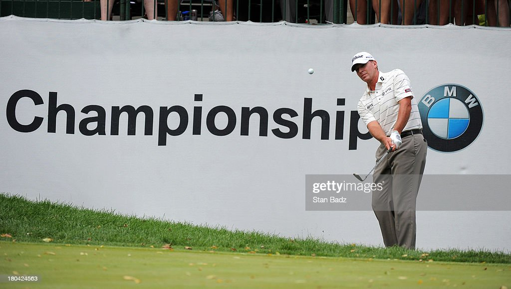Steve Stricker hits a chip shot on the ninth hole during the first round of the BMW Championship at Conway Farms Golf Club on September 12, 2013 in Lake Forest, Illinois.
