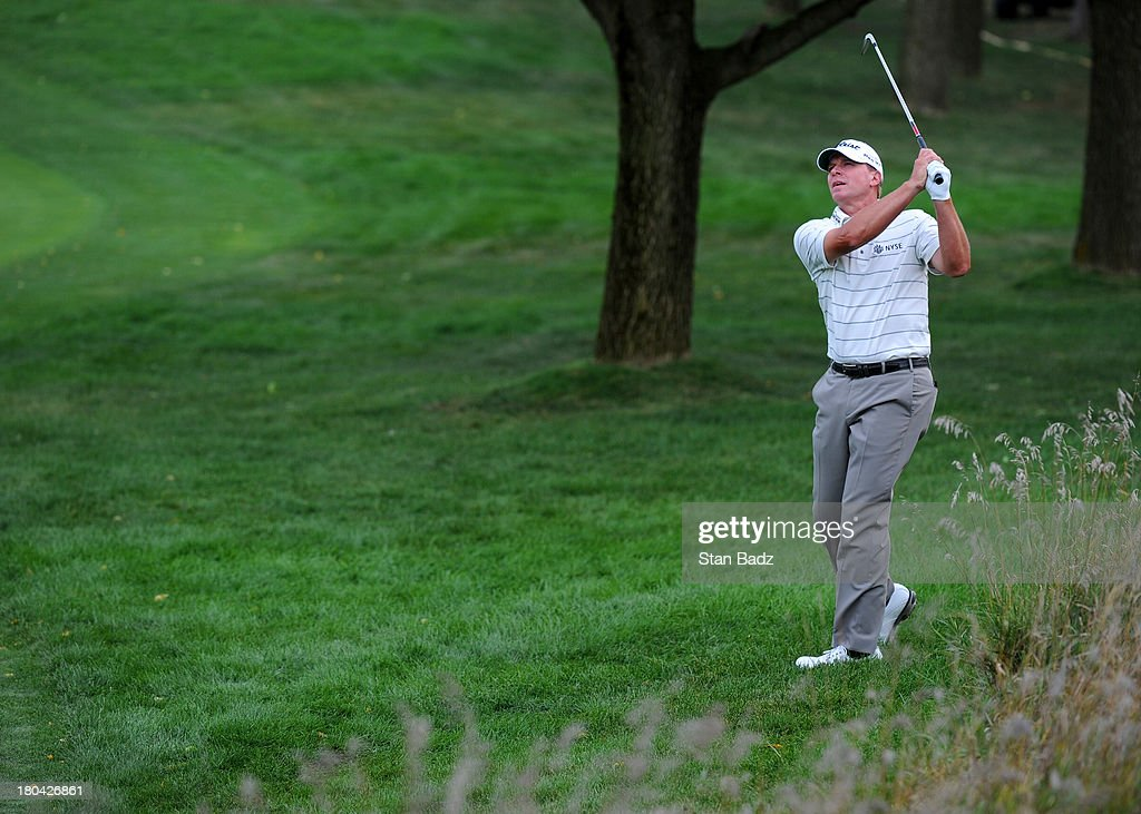 <a gi-track='captionPersonalityLinkClicked' href=/galleries/search?phrase=Steve+Stricker&family=editorial&specificpeople=239196 ng-click='$event.stopPropagation()'>Steve Stricker</a> hits a shot on the ninth hole during the first round of the BMW Championship at Conway Farms Golf Club on September 12, 2013 in Lake Forest, Illinois.